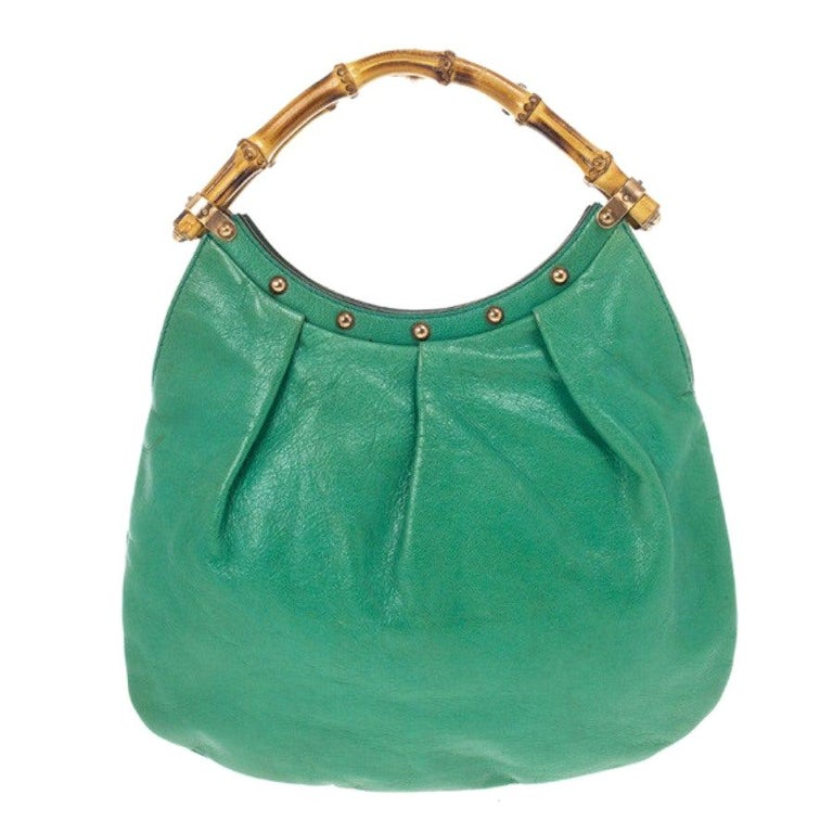db05e2f61 Gucci Leather Studded Bamboo Handle Hobo For Sale. This stylish shoulder bag  ...