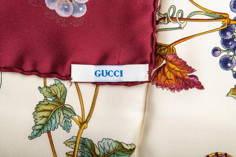Gucci silk scarf with leaves and grapes design. Hand rolled edges.