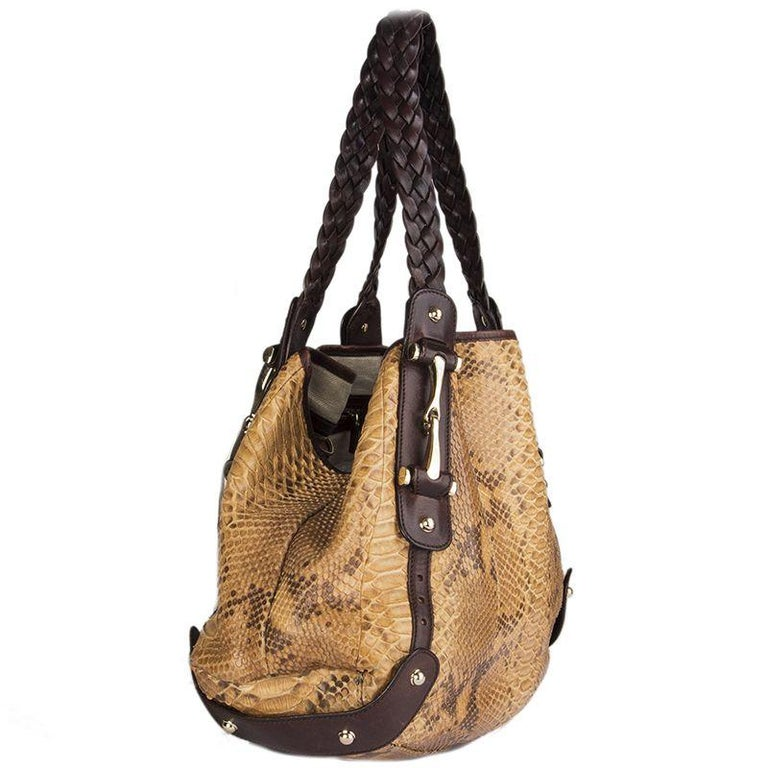 Gucci 'Pelham' horsebit shoulder bag made from light to medium brown python with dark brown leather braided handles. Lined in beige canvas (with some very faint pen mark stains) with a zipper pocket against the back. Has been carried with very soft