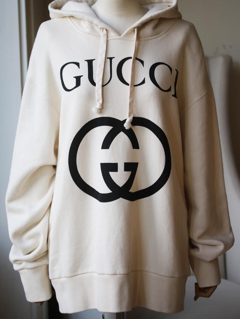 Gucci Off-white heavy felted cotton jersey. Interlocking G print. Fixed hood. Oversize fit. 100% cotton. Made in Italy.   Size: Medium (UK 10, US 6, FR 38, IT 42)  Condition: As new condition, no sign of wear.