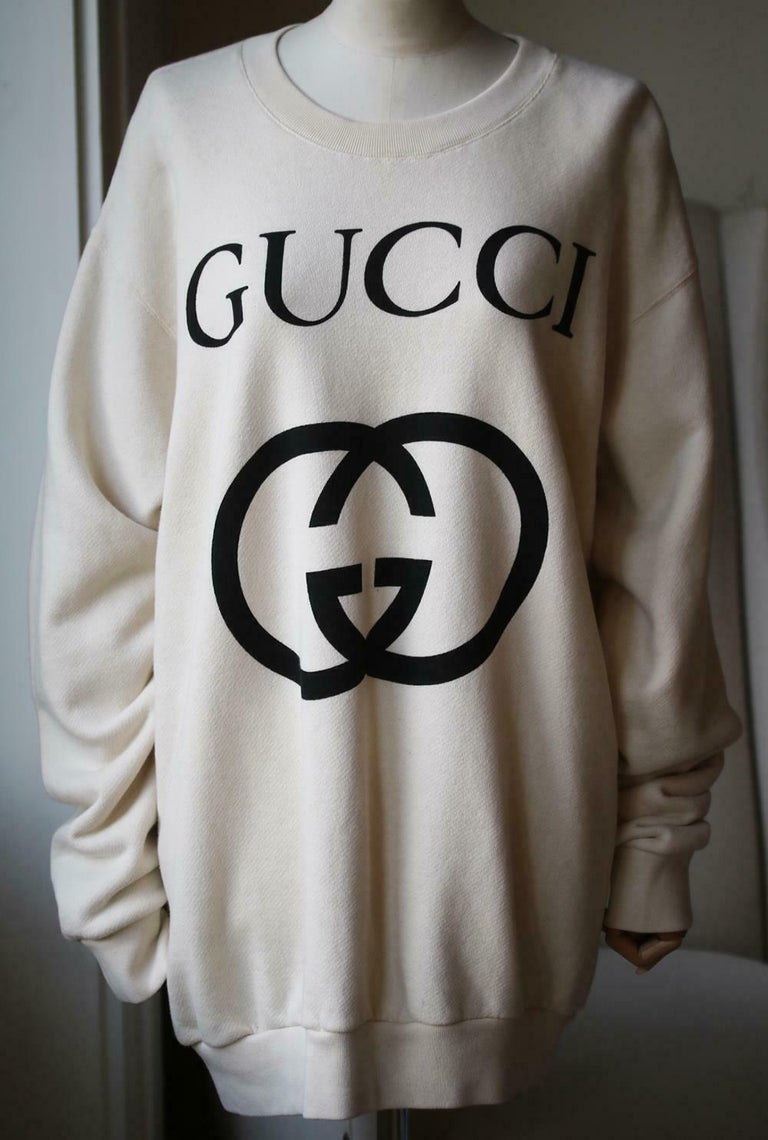 Made in Italy in a natural ivory hue, this relaxed, slightly oversized style has the iconic double G logo boldly across the centre front. 100% cotton.  Size: Large (UK 12, US 8, FR 40, IT 44).   Condition: As new condition, no sign of wear.