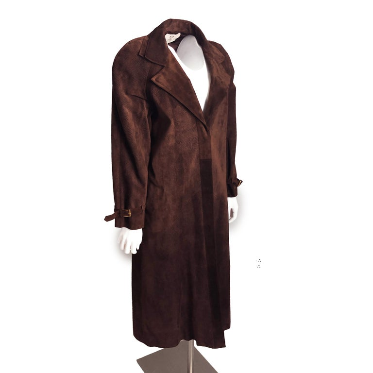 Authentic, preowned, vintage GUCCI brown chevron patterned suede leather coat (size 42) with matching skirt (sz 46). Both pieces lined; coat fastens w/hidden buttons, skirt w/zip & button. Leather clean only. Looks great worn together or as