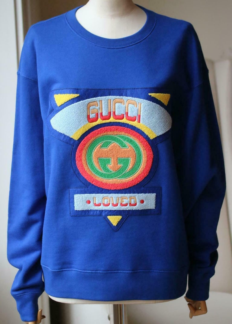 A terrycloth patch in bright colors and shapes decorates the front of this oversize sweatshirt. Blue heavy felted cotton jersey. Terry cloth Gucci '80s patch. Crewneck. Oversize fit. 100% cotton. Made in Italy.  Size: Small (UK 8, US 4, FR 36, IT
