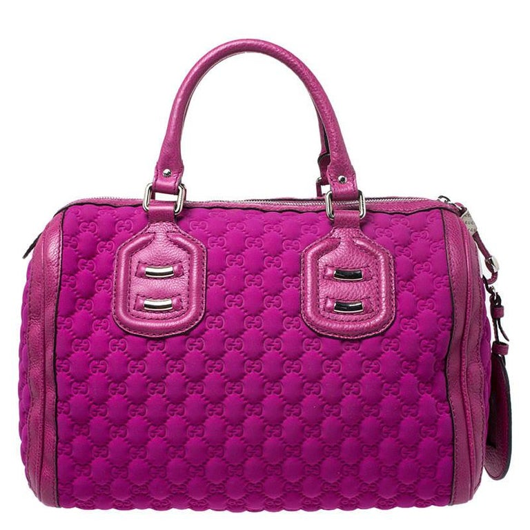 Crafted with Guccissima neoprene and leather, you will find this bag an ideal companion for all your needs. The inside nylon is lined well and sized perfectly. This Gucci magenta bag is simply unmatched in its rich and classic design.  Includes: