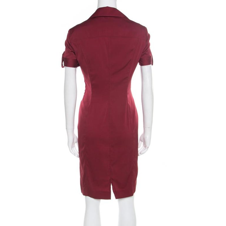 Opt for a Gucci dress if you are looking for a luxurious and urbane look! This maroon dress is made of a silk blend and features a form-fitting design. It flaunts a plunging neckline with a self-tie detailing and short sleeves. It will look amazing