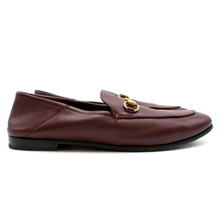 Gucci Maroon Jordan Leather Loafers  - Maroon leather with black interior - Gold-tone Metal Horsebit - Almond-toe  -Small stacked heel and sand-brown sole  Material  Leather   Made in Italy   Please note, these items are pre-owned and may show signs