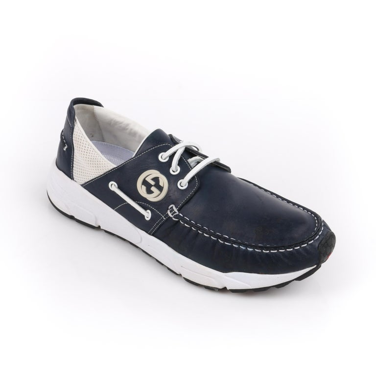 GUCCI Men's Leather Rubber Sole Lace Up Low Top Athletic Boat Shoes    Brand / Manufacturer: Gucci Style: Men's boat shoes  Color(s): Shades of white, red, black, and blue Unmarked Materials (feel of): Upper, laces: leather; lining: leather; sole,