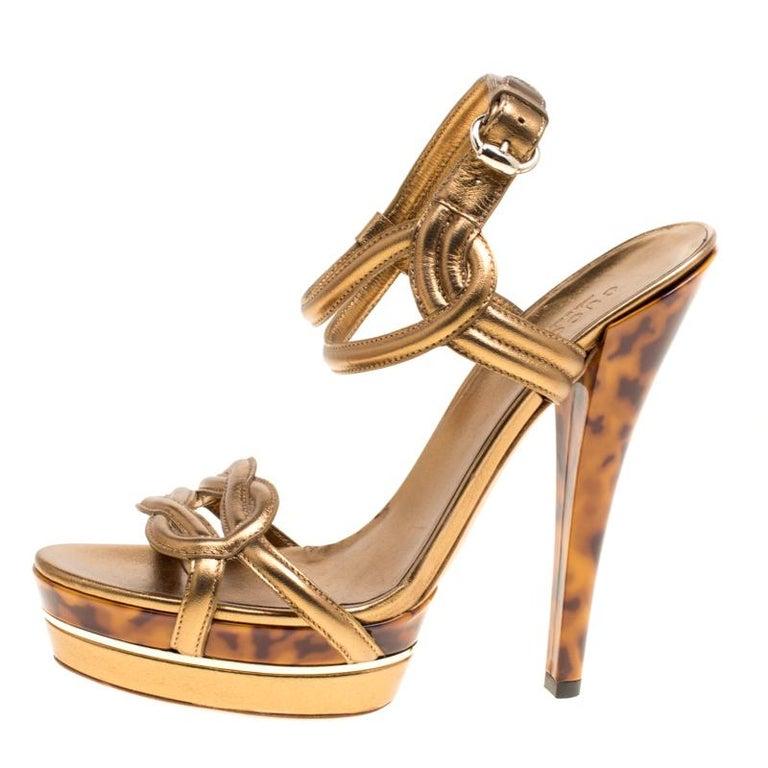 389fc08ecbf2 Gucci Metallic Bronze Leather Orchid Twist Detail Tortoise Heel Platform  Sandals For Sale 1