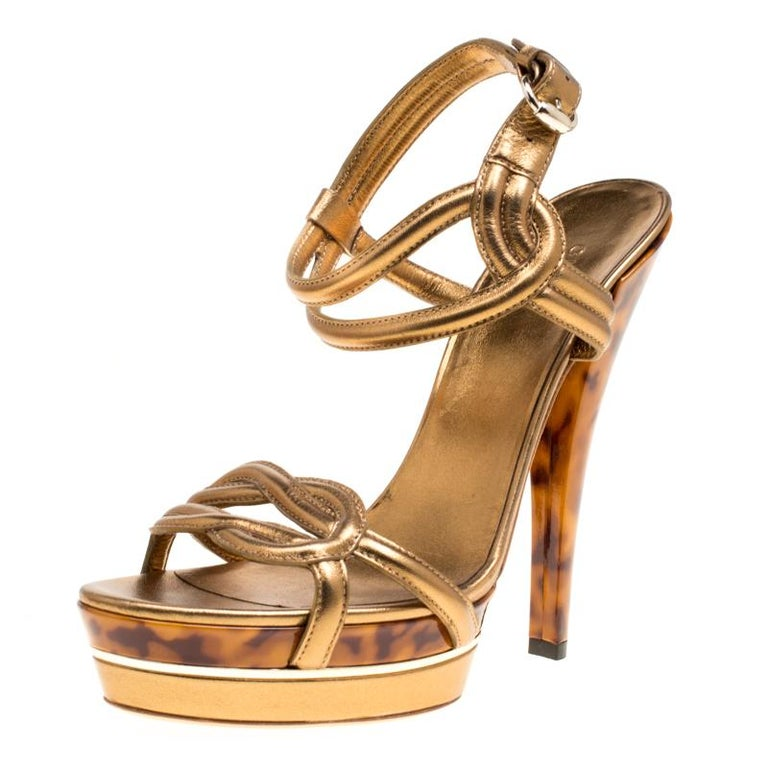 6a873767b58c Gucci Metallic Bronze Leather Orchid Twist Detail Tortoise Heel Platform  Sandals For Sale