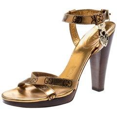 Gucci Metallic Gold Guccissima Cross Ankle Strap Lock Detail Toe Sandals Size 38