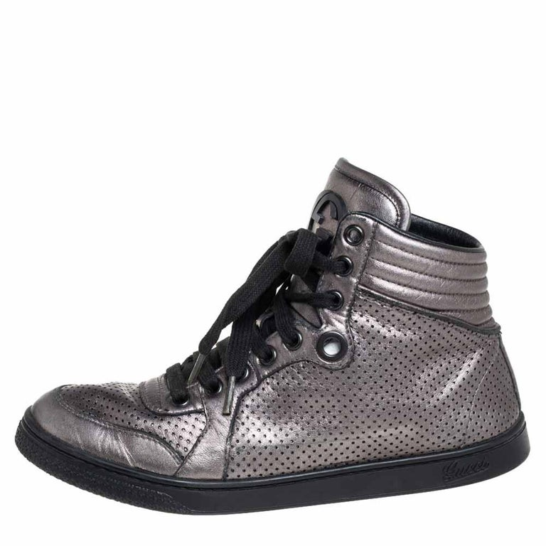 Gucci's sneakers are an example of style and comfort coming together. Crafted from grey leather, these sneakers flaunt details like the quilted counters, laces, perforations, and the raised high top. You wouldn't want to miss out on such a cool pair