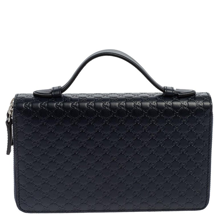 Gucci is known for its trendsetting designs that are functional as well. Crafted from Microguccissima leather, this navy blue organizer has the multiple slots for your essentials. It is sleek and comes with a handle stationed on the
