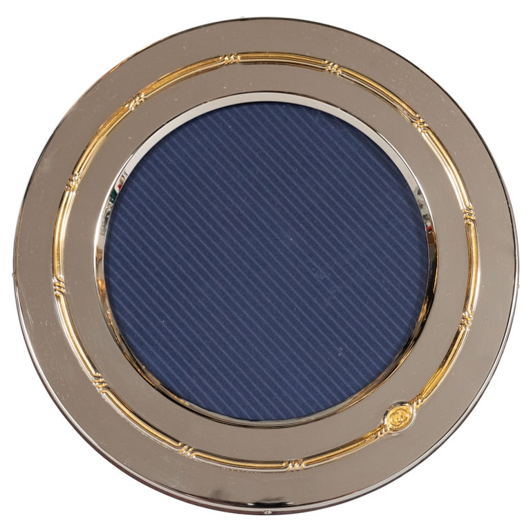 This stunning picture frame was realized by the illustrious 20th century design House, Gucci, and hand fabricated in Italy, circa 1970. It features a circular form in lustrous silver plate with interior and exterior edges with a braided rope motif