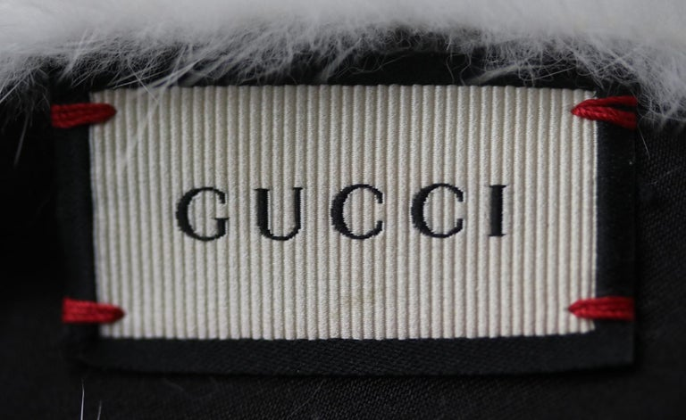 Gucci's white mink-fur twist-front headband is crafted with an elasticated black silk panel for a snug and secure fit. It's crafted in Italy, and will work well with the label's eclectic printed pieces. Snow-white twist-front panels. Gathered