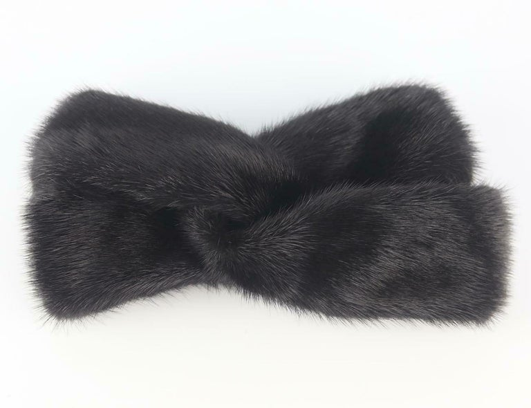 Gucci's black mink-fur headband, it has a twist-front and elasticated back which is wide enough to cover your ears, making it perfect for skiing or snowy city breaks. Black mink-fur. Slips on.  100% Mink fur; lining: 100% silk.   Dimensions: