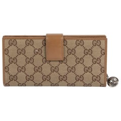 Gucci Monogram Canvas Wallet