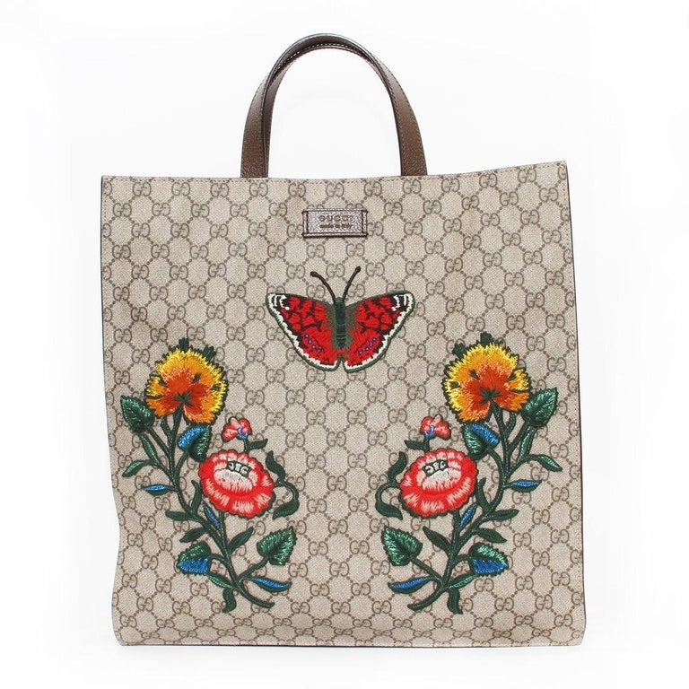 GG floral tote by Gucci GG monogram exterior  Floral patch details  Two leather top handles  Magnetic top closure  Two interior zip pockets Gold-tone hardware  Removable leather strap  Adjustable leather strap  Canvas interior  Includes dust bag