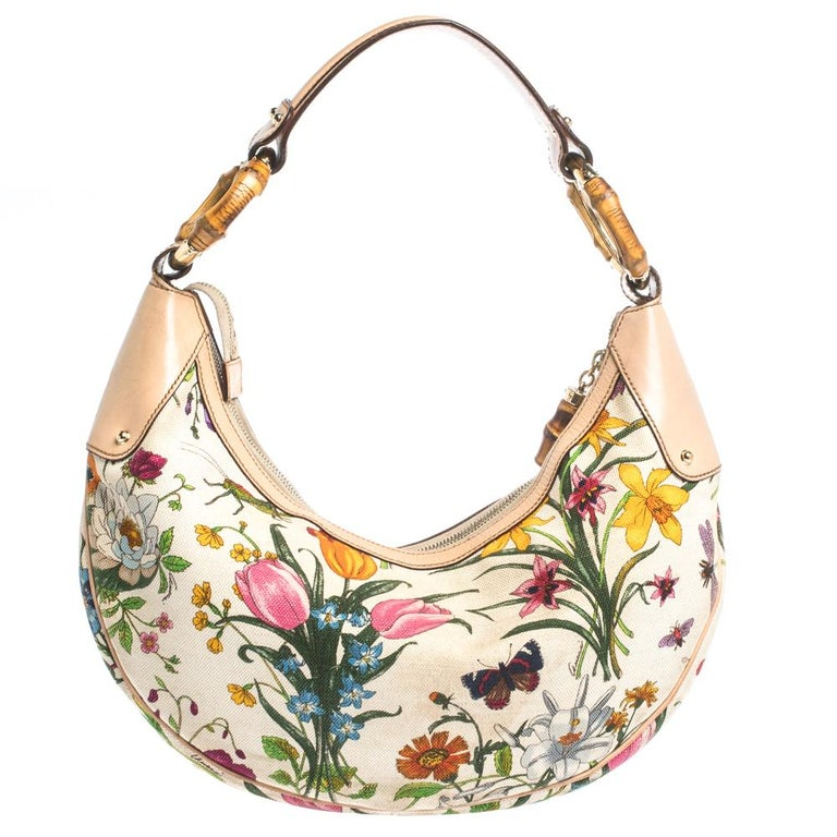 Hobos are all the rage with fashionistas at the moment, especially if designed by Gucci. This pretty multicolored hobo is crafted out of canvas and leather and features a bamboo ring-detailed strap. With a canvas-lined compartment and a zip pocket