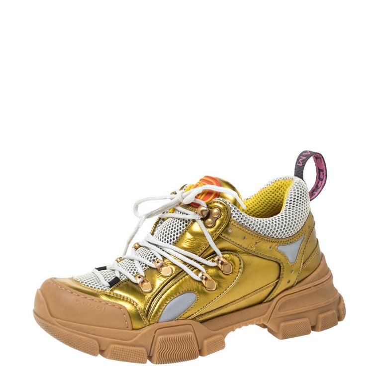 These Gucci Flashtrek sneakers are specially fashioned for those with a taste of high fashion. They are crafted from leather, suede as well as mesh into a boot-like silhouette. The gold-tone hardware, laces and the chunky soles merge to complete the