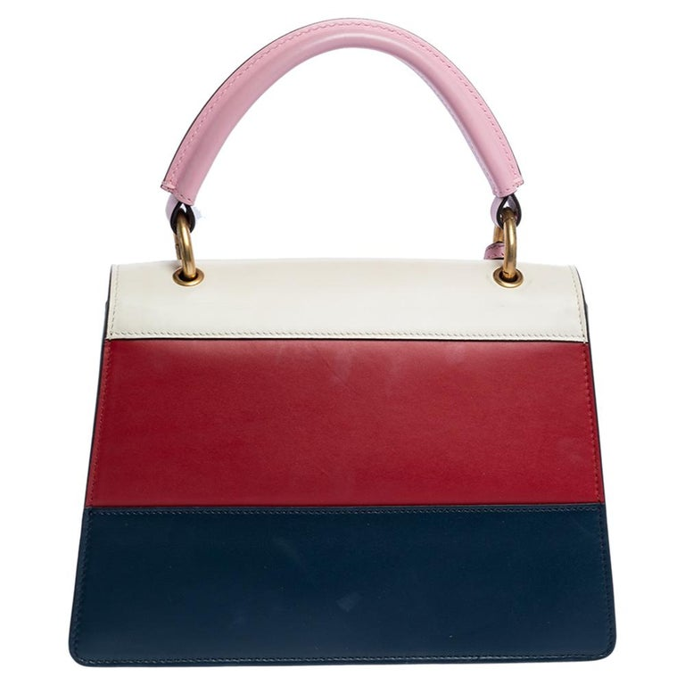 From the house of Gucci, this Queen Margaret bag is an outstanding fusion of brilliance and timeless style. Exhibiting an impressive design, the top handle leather bag has an embellished flap, a top handle and a suede interior.  Includes: Strap,