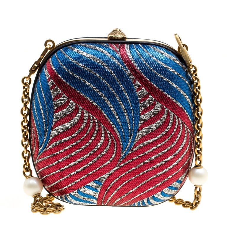 Creations so breathtaking and creative are hard to find! This awe-inspiring Minaudiere clutch from Gucci is just what you need to grab all the attention at those soirees and parties. We love how minute attention has been given to each detail which