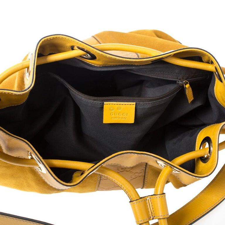 Gucci Mustard Suede and Leather Drawstring Hobo In Good Condition For Sale In Dubai, Al Qouz 2