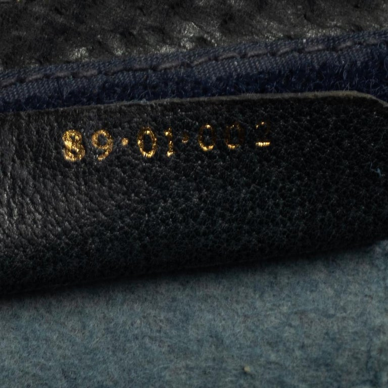 Women's Gucci Navy Blue GG Canvas and Leather Vintage Web Clutch For Sale