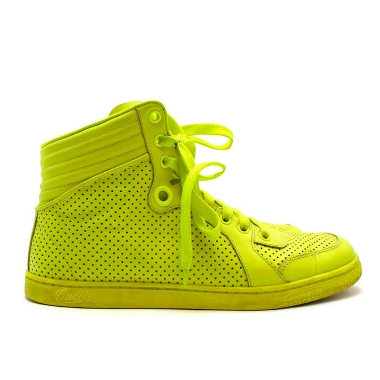 Gucci Neon Yellow Perforated Leather High Top Trainers   -Made of smooth Perforated leather  -Luxurious soft leather lining  -High top style  -Rubber soles for adherence  -Logo to the tongue  -Branded to the sides   Materials: Main-leather