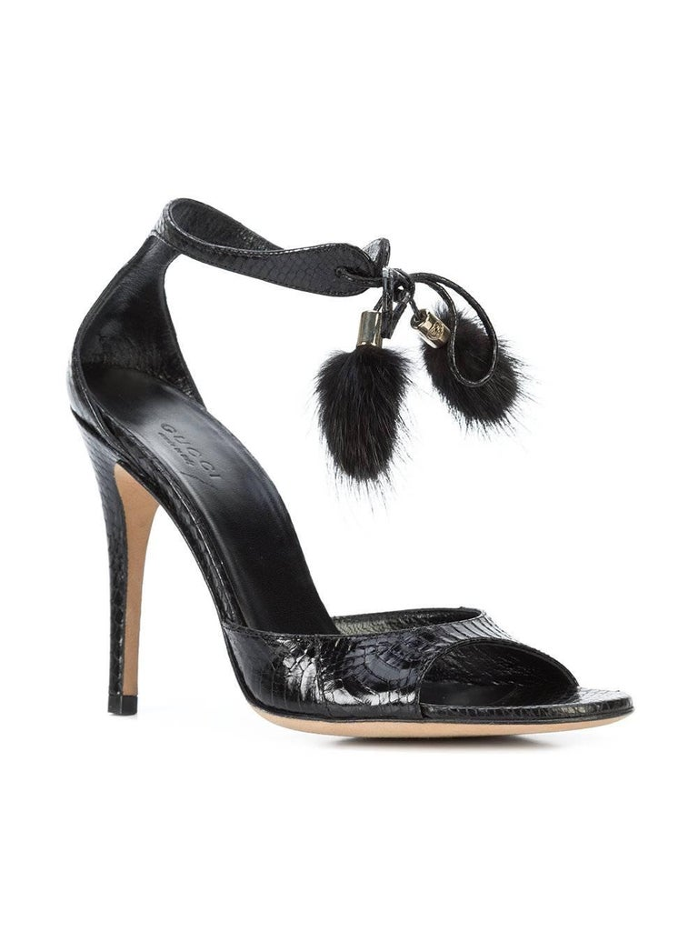 """Gucci New Black Embossed Snakeskin Fur Pom Pom Evening Sandals Heels in Box  Size IT 36 Embossed snakeskin Fur (Mink) Ankle tie closure Made in Italy Heel height 4"""" Includes original Gucci dust bag and box"""