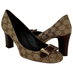 Gucci New GG Canvas Buckle Bow Pumps