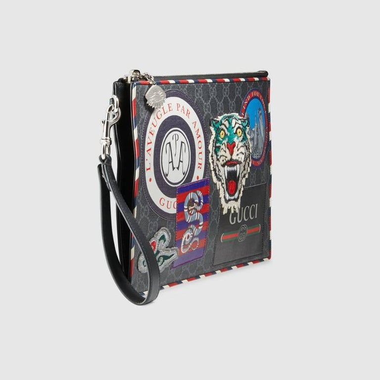 65491cfe3d7 Gucci Night Courrier GG Supreme pouch For Sale. The concept of travel  continues to be a source of inspiration for the House. The