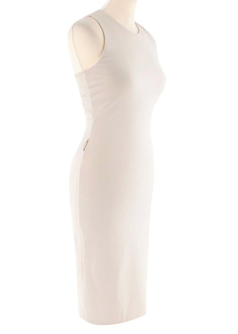 Gucci Nude Fitted Knot Back Dress  - Round neck  - Midi length - form fitting   - Racer twist back straps - Side zip/hook fastening - Belt loops  Material - 98% viscose - 2% elastane - Dry clean only  Made in Italy  Please note, these items are