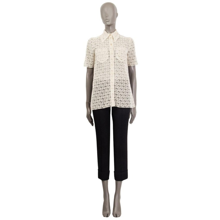100% authentic Gucci GG Macrame short sleeve shirt in sheer off-white cotton (77%) and polyester (23%) (please note content tag has been removed). Features a point collar and front pockets. Has been worn and is in excellent condition.  See matching