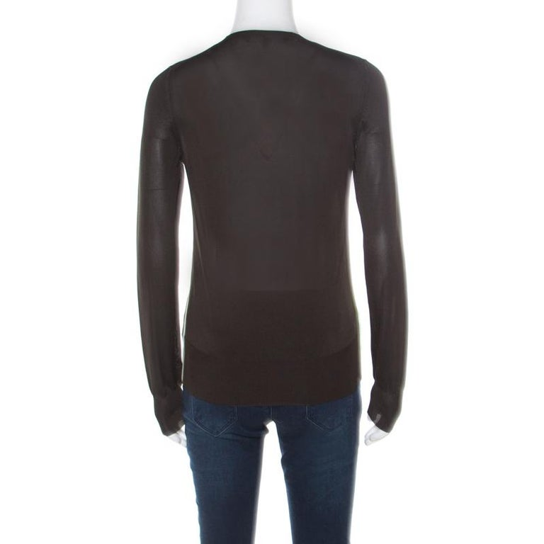 Gucci brings you this olive green sweater that is well-made and so easy to slip on! The sweater has a V neckline, long sleeves and the signature GG logo detail.  Includes: The Luxury Closet Packaging
