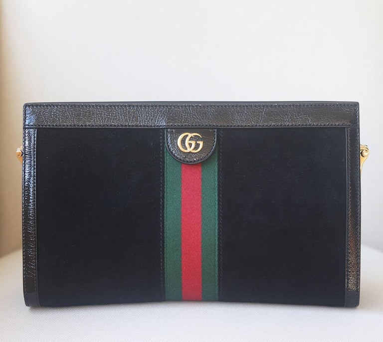 Gucci's Resort '18 show was held in Florence's 'Palazzo Pitti' museum where Renaissance art, a harpist and this 'Ophidia' shoulder bag enchanted the room. Crafted from black suede edged with black patent-leather trims, this style is enhanced with
