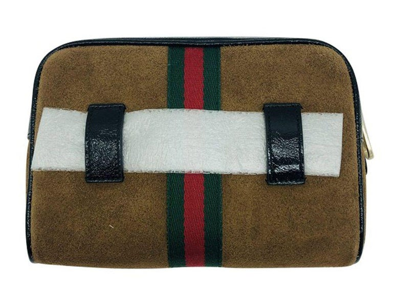 Gorgeous sleek suede Ophidia Belt bag by Gucci. Made from luxurious suede and patent leather with the iconic web detail. Purchased and stored so never used and in new condition.  BRAND Gucci  ACCESSORIES Care Card, Dust