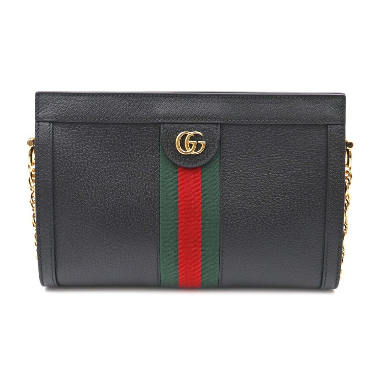 The Guccismall chain Ophidia shoulder bag was introduced in a new iteration for Pre-Fall 2019, crafted from black leather with inlaid green and red Web stripe. The coveted style is defined by small Double G details at the front tab—a contemporary