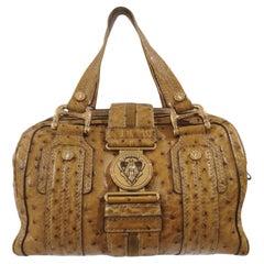 Gucci ostrich speedy light brown handle bag