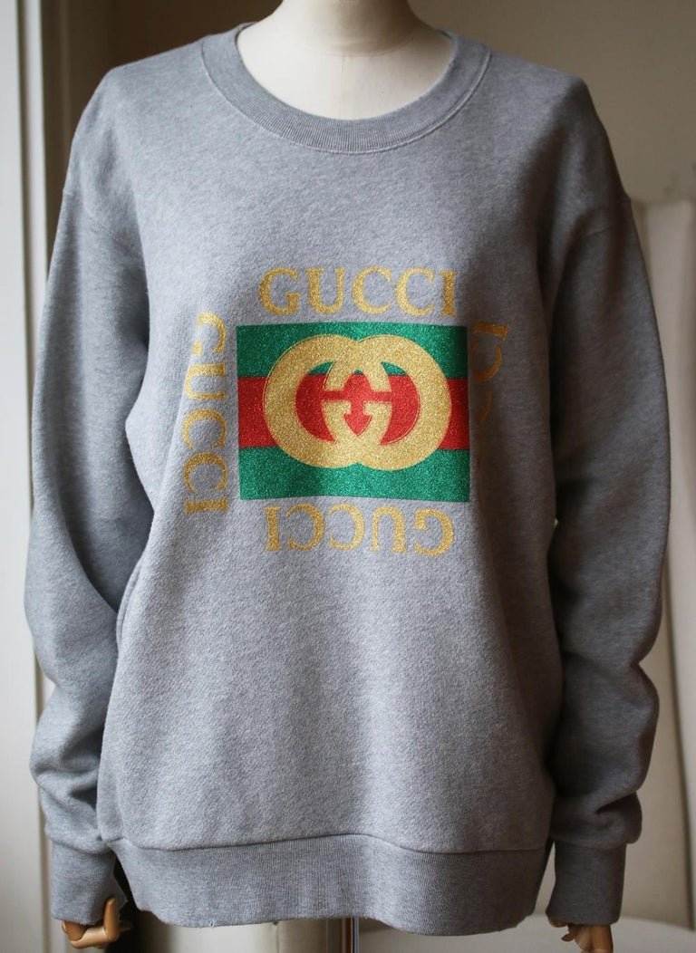 Printed with a glittered version of Gucci's '80s-era emblem, this oversized sweatshirt is cut from soft cotton-terry and turns to reveal an appliquéd tiger at the back. Multicolored cotton-terry. Slips on. 100% cotton. Made in Italy.  Size: Small