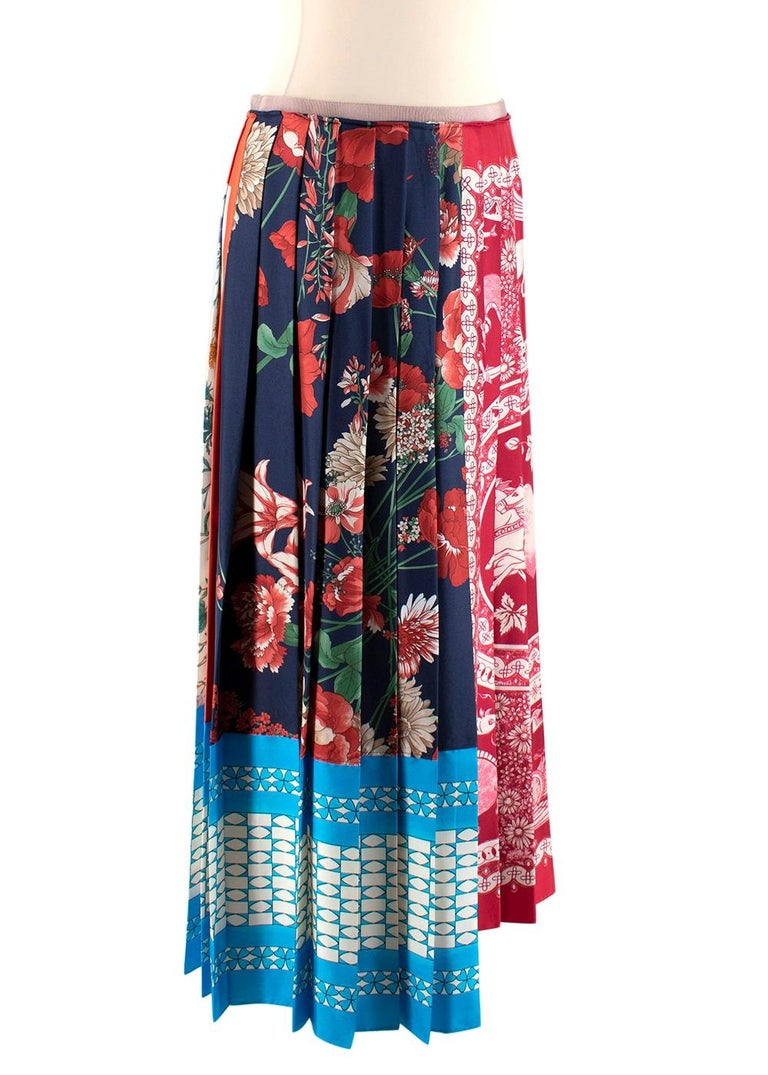 Gucci Patchwork Print Pleated Asymmetric Silk Skirt  - Made of luxurious soft silk  - Pleated texture  - Gorgeous scarf patchwork motif  - Snap fastening  - Timeless versatile design   Materials: 100% silk   Made in Italy   PLEASE NOTE, THESE ITEMS