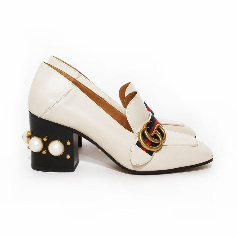 Gucci Pearl Heel Loafer by Alessandro Michele Boot Made in Italy  Spring 2016 White leather Blue and red web Antiqued gold interlocked GG  Square style toe Gold stud and pearl heel embellishments Stacked block heel  Great condition; Wear on soles.