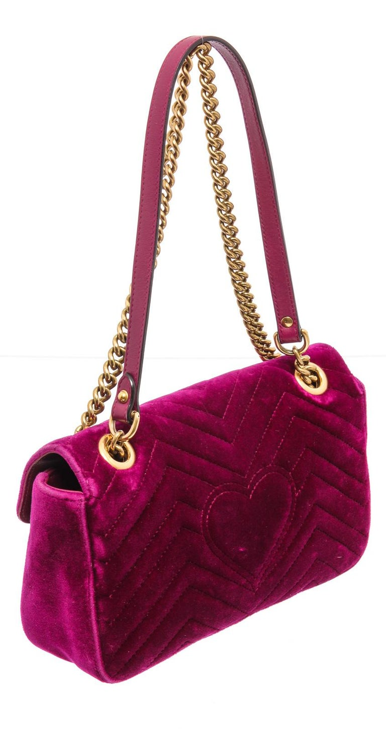 Pink chevron velvet GG Matelassé shoulder bag, with gold-tone antique hardware, single chain and leather shoulder strap, and double marmont GG logo at front.    21498MSC