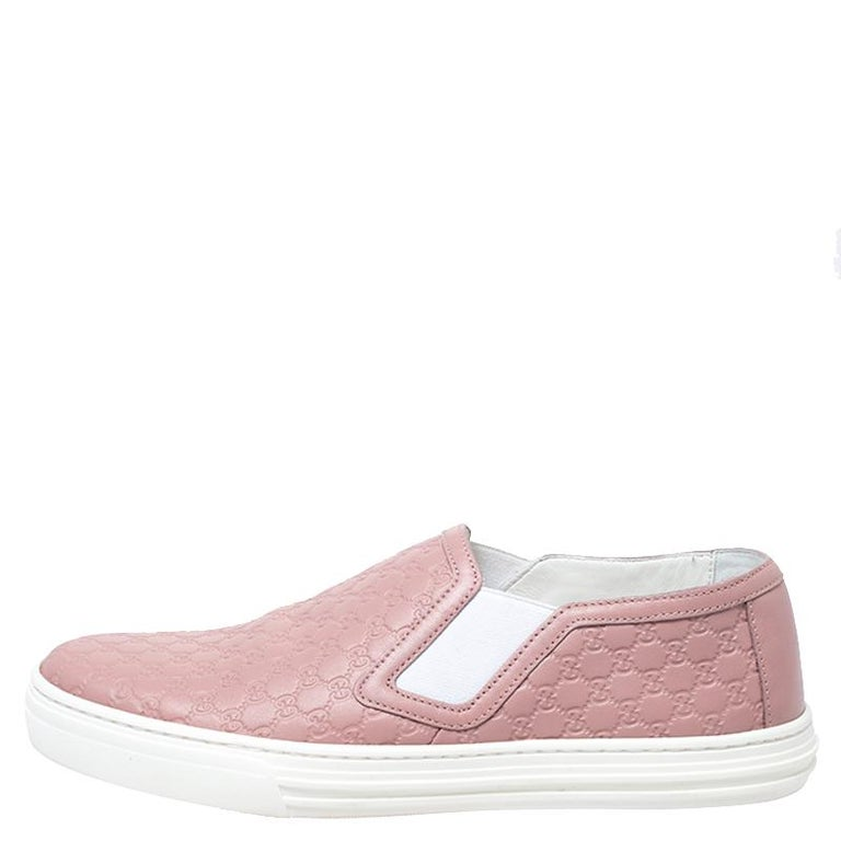 Look stylish in your casual looks with these Gucci sneakers. Constructed in leather, these shoes feature round toes and Microguccisima embossing all over. They are set on highly comfortable soles to assist you every day.  Includes: Original Dustbag,