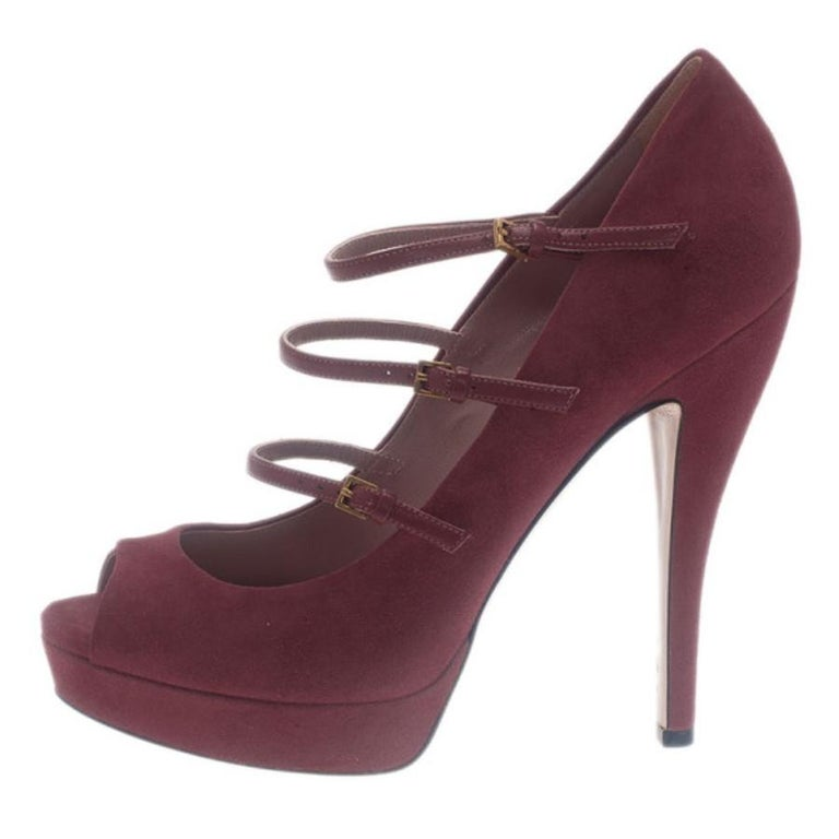 Add the prefect pop of color to your oufit with these Gucci Platform Pumps. Made from pink colored suede, they are coupled with rounded peep toes, three buckle adjustable straps across their vamps, 2cm platforms and 14cm heels. Leather lined, their