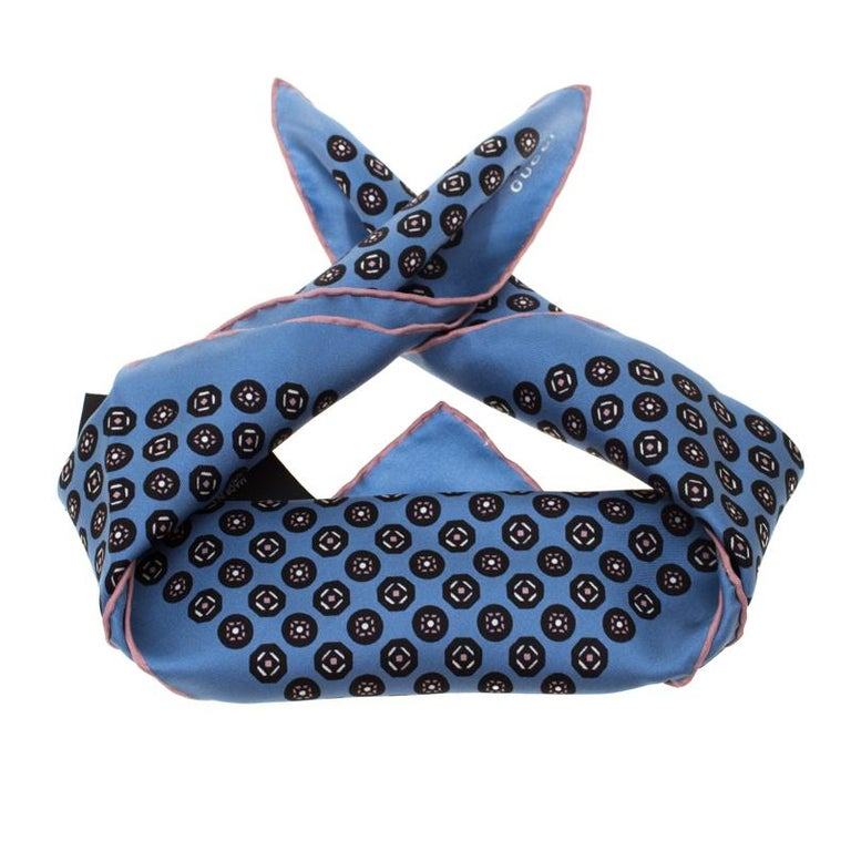 Featuring an understated style, this chic pocket square from Gucci carrying a blue hue is a sophisticated piece which will add a similar appeal to your ensemble. It is cut from silk with neatly rolled edges.  Includes: The Luxury Closet Packaging,