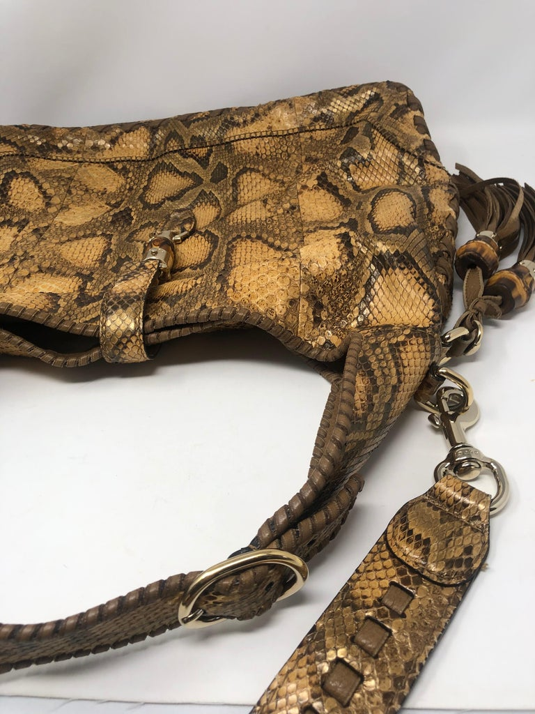 Gucci Python Hobo Bag with bamboo tassel. Excellent condition. Bag has longer strap and can worn without. Braided handle with goldtone hardware. Guaranteed authentic.