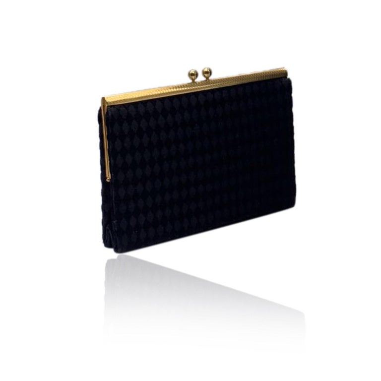Beautiful rare GUCCI evening bag in black satin. Gold metal hardware. Framed design with clasp closure on top. Black satin lining with 2 side open pockets. 'Made in Italy by Gucci' embossed inside.   Details  MATERIAL: Satin  COLOR: Black  MODEL: