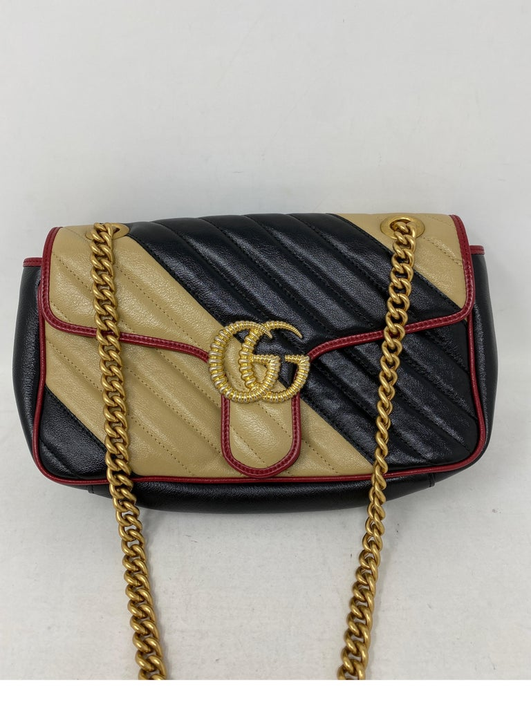 Gucci Red and Black Marmont Bag. Beautiful Gucci bag in excellent condition. Can be worn as a crossbody or doubled as a shoulder bag. Guaranteed authentic.