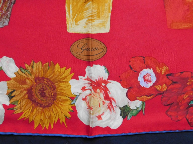 A vivid design of painted flower pots and Van Gogh-esque sunflowers on the perfect deep lipstick red background finished with a hand rolled and sewn blue edge. The twill silk has a rich hand and drapes beautifully.