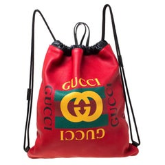 Gucci Red Drawstring Print Leather Backpack